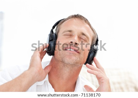 Man listening to some music at home