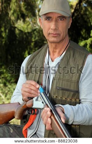 Man loading a shotgun
