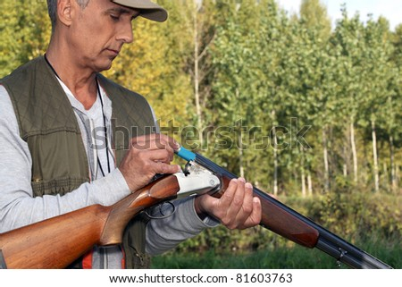 Man loading cartridges into a shotgun