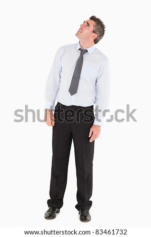 Man looking at a copy space against a white background