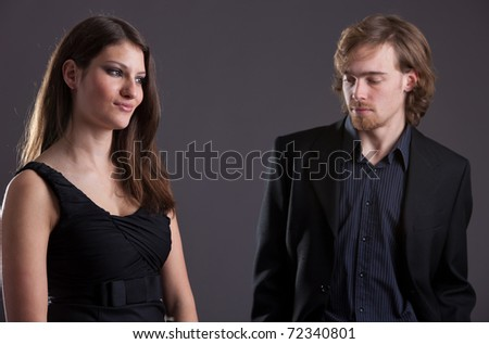 Man looking at a pretty woman who appears not to be interested