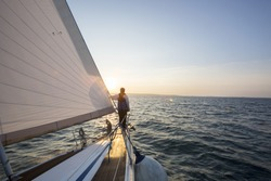 Man Looking At Beautiful Sea From Bow Of Sail Boat