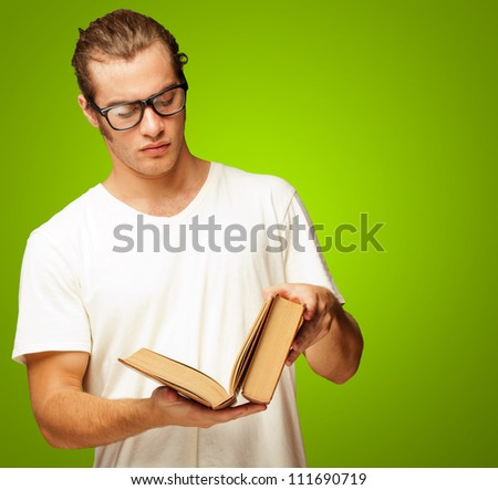 Man Looking At Book On Green Background