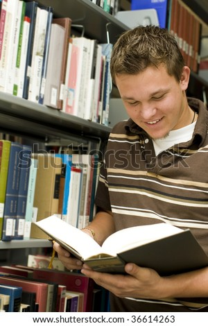 Man looking at books in a library