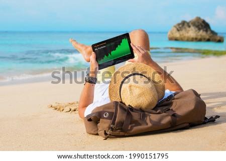Man looking at his investment portfolio performance Stock photo ©