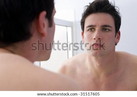 Man looking at his reflection
