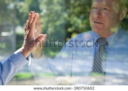 Man looking at his reflection ストックフォト ©