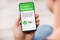Man Looking At Online Petition Form On Smartphone