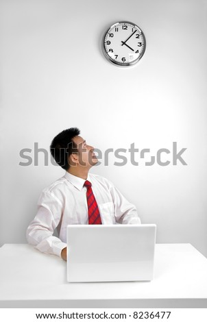 Man looking at the time in office - stock photo