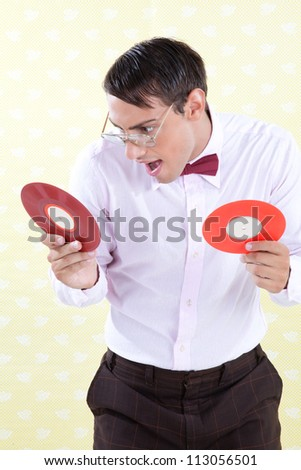 Man looking at vinyl record with excited expression