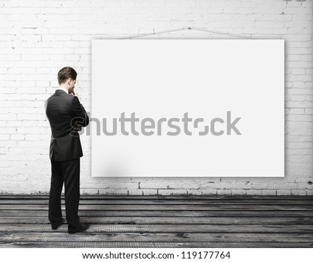 man looking empty poster on wall