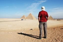 Man looking on pyramids