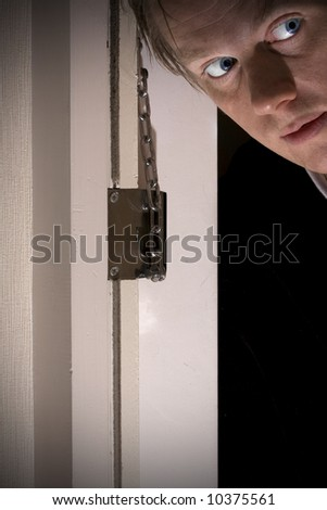 Man looking out of door opening