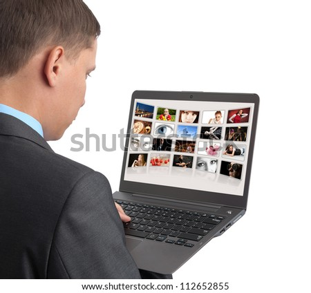 man looking some pictures on the laptop