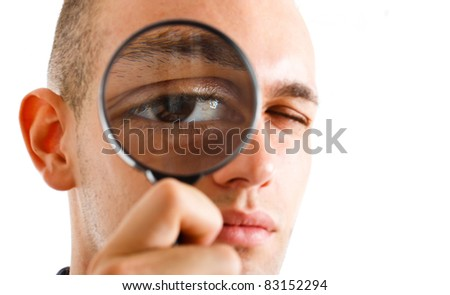 Man looking through a lens