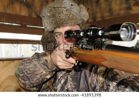 Man looking through hunting scope