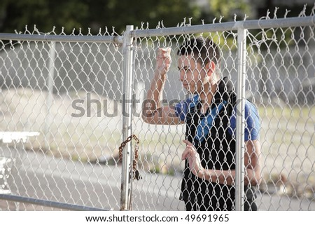 Man looking through the fence