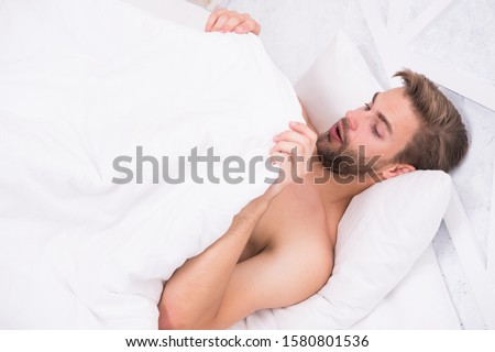 Man looking under blanket. Morning wood formally known nocturnal penile tumescence common occurrence. Male reproductive system. Why men get morning erections. Normal erections occur. Guy relax in bed. Сток-фото ©