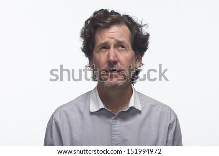 Man looking up and thinking, horizontal