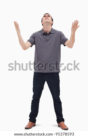Man looking up to the heavens against white background
