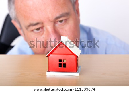Man looks at model home