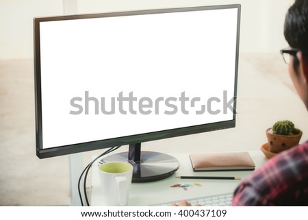 Man looks at the screen computer.
