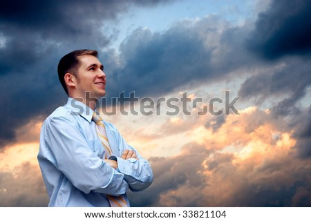 man looks on  sky with clouds