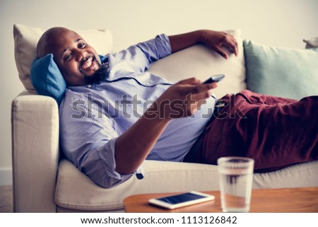 Man lying on the couch after work