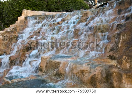 Man Made artificial water falls with blue tinted water