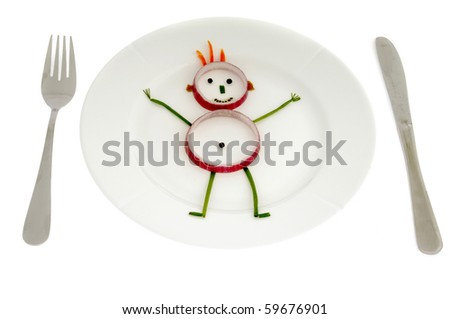 Man made of vegetables on a dish.