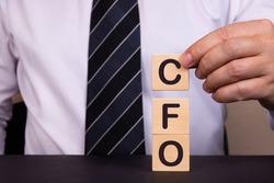 Man made word CFO with wood blocks.