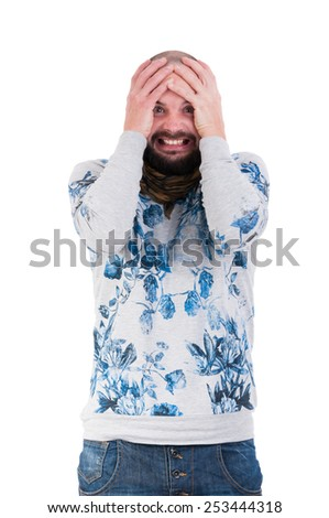 Man making a crazy desperation face by grabbing his head
