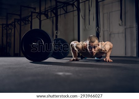 Man making burpees during strength training