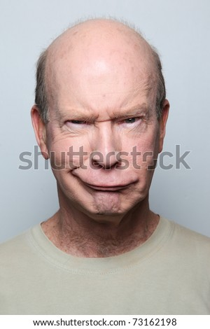 Man making funny face and grimacing