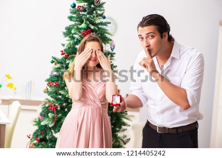 Man making marriage proposal at christmas day