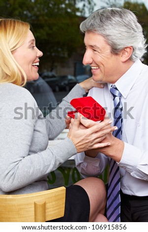 Man making proposal of marriage to his happy woman
