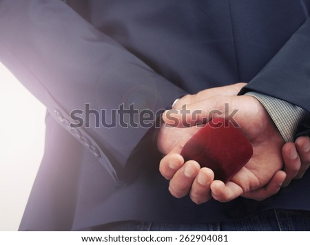 man making proposal with wedding ring and gift box, wedding concept, happy family