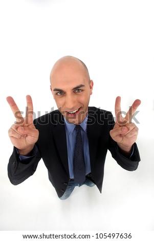 Man making victory gesture