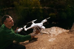 Man Manages Quadrocopters. Remote Control For The Drone In The Hands Of Men