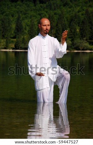 Man meditating in lake