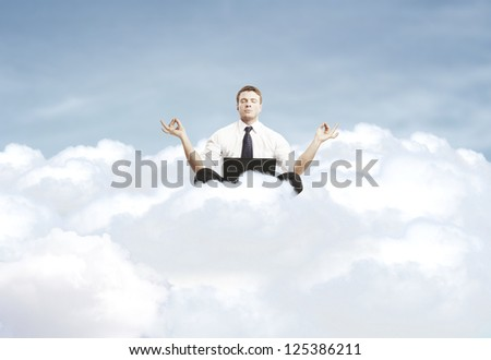 man meditating on a cloud