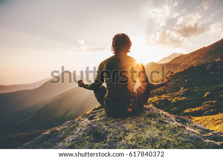 Shutterstock Man meditating yoga at sunset mountains Travel Lifestyle relaxation emotional concept adventure summer vacations outdoor harmony with nature