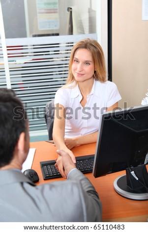 Man meeting financial adviser in office