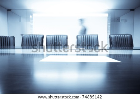 man move in Meeting room