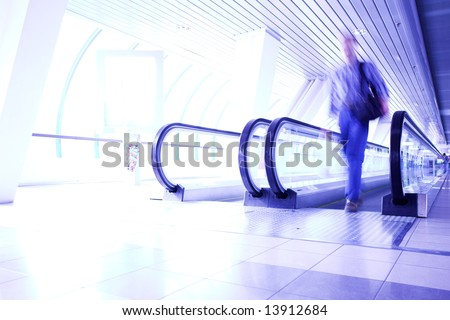 Man moving in violet glass corridor