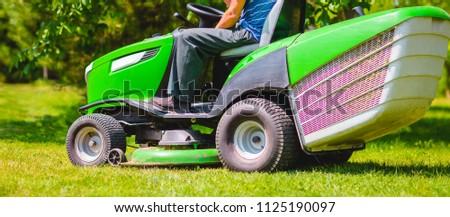 man mowing, lawn mower, meadow #1125190097