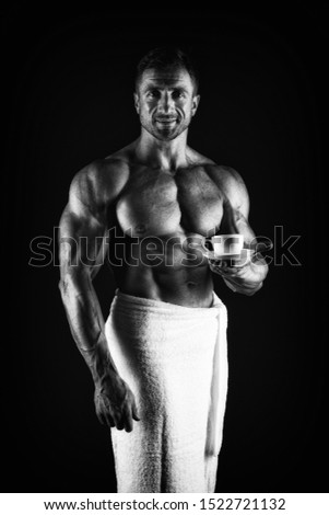 Man muscular fit bare torso. Athlete with six pack and ab muscles. Sport and fitness. Body hygiene concept. Bodybuilder naked body. Morning coffee. Sexy sportsman wipe body towel after shower.