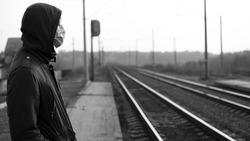 Man near the railroad, world quarantine,epidemic coronavirus outbreak.