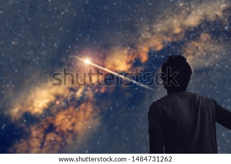 Man observing the night sky and Milky way with a shooting star trail. My astronomy work.