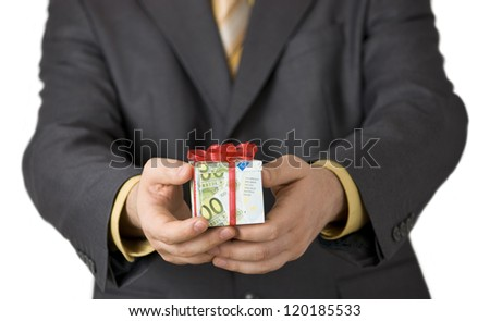 Man offering financial aid in a gift box wrapped in euro banknotes.